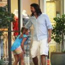 Foo Fighters frontman Dave Grohl and his wife Jordyn Blum take their two daughters Violet & Harper, along with their newborn baby, out for dinner at the Beverly Glen Center in Los Angeles, California on August 19, 2014