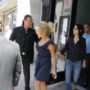 Pamela Anderson - Leaving Press Conference At The Globe - July 15 2010