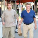 Ryan O'Neal and his son Redmond seen leaving a restaurant after lunch in Brentwood, California on December 27, 2013