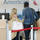 Emma Roberts with Garrett Hedlund – Seen at LAX in Los Angeles