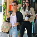 Kendall Jenner flashes her toned midriff while reuniting with Hailey Baldwin in LA... as it's claimed 'new beau' Lewis Hamilton wants to take her on a 'proper date'