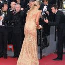 How embarrassing! A bra-less Lady Victoria Hervey gets kicked off the red carpet in Cannes after posing for too long - 454 x 490