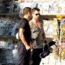 Colin Farrell chats with some classmates after a yoga class in Los Angeles