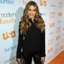 her famous curvy figure in a pair of skintight leather trousers as she attends Modern Family Fan Appreciation Day