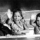 Kate Winslet and her two kids, Carrie Mullan and Bella Rizza wave good-bye from the train in Hideous Kinky