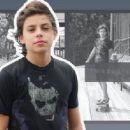 Jake T. Austin is skateboarding