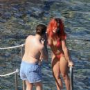 Rita Ora in Red Bikini at the beach in Tuscany