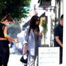 Camila Morrone – Out for a stroll with her stylist in West Hollywood