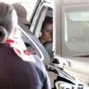 Kristen Stewart in Tight White Tank Top – Arriving at LAX airport in LA