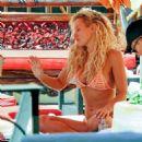 Nicky Whelan in Bikini on the pool in Las Vegas - 454 x 470