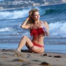 Caitlin O'Connor wears a sexy red bikini as she does a new photo shoot for 138 Water in Pacific Palisades, California on January 5, 2015 - 454 x 316