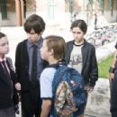(L-r) JOLIE VANIER as Helvetica Black, DEVON GEARHART as Cole Black, JIMMY BENNETT as Toe Thompson, RACER RODRIGUEZ as Bully #1 and ROCKET RODRIGUEZ as Bully #2 in Warner Bros. Pictures' magical fantasy adventure 'Shorts.' Photo by Van Redin - 454 x 302
