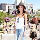 Actress Jamie Chung, wearing American Eagle Sky High Demin, attends American Eagle Outfitters Celebrates the Budweiser Made in America Music Festival during day 1 at Los Angeles Grand Park on August 30, 2014 in Los Angeles, California - 395 x 594