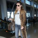 Heidi Klum is seen arriving on a flight at LAX airport in Los Angeles, California on January 23, 2017 - 400 x 600