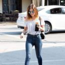 Actress and singer Lucy Hale stops by Starbucks in Los Angeles, California to pick up an iced coffee on August 24, 2016 - 454 x 592