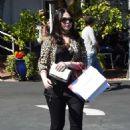 Michelle Trachtenberg in a leopard print jacket at Fred Segal in LA - 454 x 662
