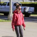 Ashley Tisdale in a red hoodie and black leggings for a walk in Los Feliz