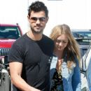 Taylor Lautner and his girlfriend  were seen leaving Fred Segal in West Hollywood, California on March 23, 2017 - 441 x 600