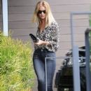 Model Rosie Huntington-Whiteley is spotted stopping by her office in West Hollywood, California on June 27, 2016
