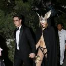 "Adam Levine and Behati Prinsloo donned getups from the ""Eyes Wide Shut"" masquerade scene for Halloween last night (October 31)"