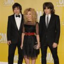 Kimberly Perry and Reid Perry from the musical group The Band Perry arrive at the 46th annual Country Music Awards - 438 x 600