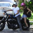 Josh Hutcherson, who was showing off his blonde hairdo, stops by a female friends house to pick her up on his motorcycle in Hollywood