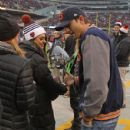 Mila Kunis and Ashton Kutcher: stand on the sidleines before the Chicago Bears take on the Green Bay Packers at Soldier Field