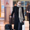Gigi Hadid – Arrives at JFK Airport in NYC