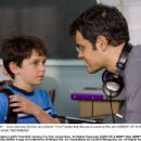 Actor Zachary Gordon and director Thor Freudenthal discuss a scene on the set of DIARY OF A WIMPY KID. Photo credit: Rob McEwan