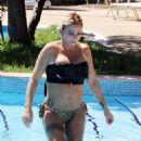 Katie Price – Wears leopard printed bikini by the poolside in Turkey - 454 x 519