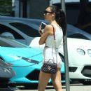 Cara Santana in White shorts while getting her car serviced in Los Angeles