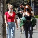 Lili Reinhart – With Madelaine Petsch take their dogs for a walk in Vancouver