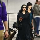 Dita Von Teese – Arrives at the airport in Miami - 454 x 603