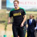 Prince Harry and Usain Bolt strike a pose while checking out the Usain Bolt Track at the University of the West Indies on Tuesday (March 6) in Kingston, Jamaica