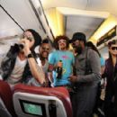 Black Eyed Peas performing on a Virgin Blue flight