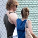 Couple Emma Roberts and Evan Peters leaving a pool together in New Orleans, Louisiana on October 15, 2013 - 397 x 594