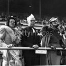 (l to r) Edith Roark, Tommy Manville, and Dolly Goering standing at the rail at the Kentucky Derby at Churchill Downs, Louisville, KY, May 8, 1937