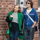 Andy Samberg and his Girlfriend holding hands while