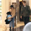 Vanessa Hudgens and Austin Butler at LAX Airport in LA - 454 x 490