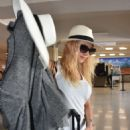 Katheryn Winnick at LMM airport in San Juan - 454 x 750