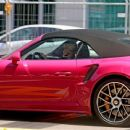Michelle Hunziker – Spotted at her pink porsche in Milan - 454 x 373