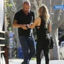 Actor Dominic Purcell cozies up to a mystery girl after enjoying lunch with her at Granville in Studio City, California on January 14, 2015 - 454 x 569