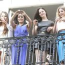 Selena Gomez, Vanessa Hudgens, Rachel Korine, and Ashley Benson waving to their fans from their balcony at Bristol hotel in Paris, France, on February 17th 2013 - 454 x 323