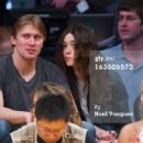 Emmy Rossum and Tyler Jacob Moore at the LA Lakers game - 454 x 372