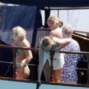 Queen's Roger Taylor uses a pole and shoots an AIRGUN at jellyfish whilst on a boat ride with his wife and children during sun-soaked holiday in Spain, 31 May 2019 - 454 x 550