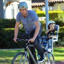 Josh Duhamel is spotted enjoying a bicycle ride with his growing son Axl on January 8, 2016 in Brentwood - 441 x 600