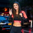 Victoria Justice in Tights and Sports Bra – Out in Chelsea - 454 x 629
