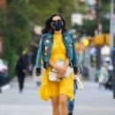 Famke Janssen – In a yellow dress and denim jacket out New York