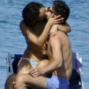 Dominic Cooper sunbathing and kissing a mystery woman while vacationing in Ischia, Italy (July 11)