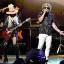 Orianthi and Sammy Hagar perform onstage during MusiCares Person of the Year honoring Aerosmith at West Hall at Los Angeles Convention Center on January 24, 2020 in Los Angeles, California - 454 x 399